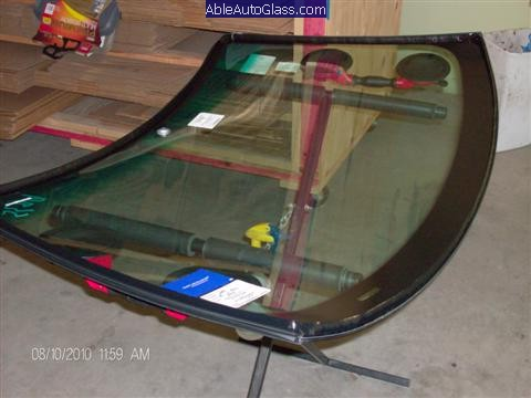 BMW 323i 1999 Windshield Replace-Triangle Bead of Adco Titan Pro 1 applied to Glass