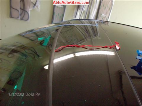 BMW 5451 2005 Windshield Replace Houston, TX-Pulling Tap off Top Molding