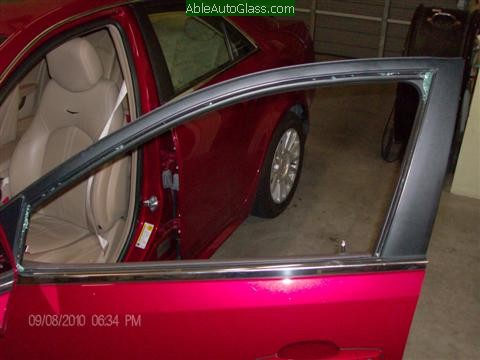 Cadillac CTS 2010 Front Door Replacement Looking at the Broken Glass