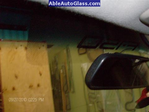 Ford F150 2005-2008 Standard Cab Windshield Repalcement - Inside View of F150 Logo Behind Rear-view Mirror