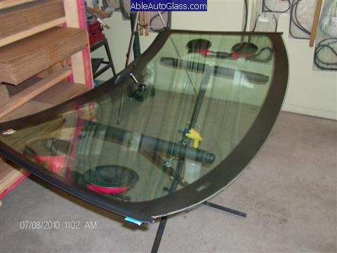 Ford Super Duty Truck 2008-2011 Front Windshield Replacement - Two Suction Cups Applied to Windshield