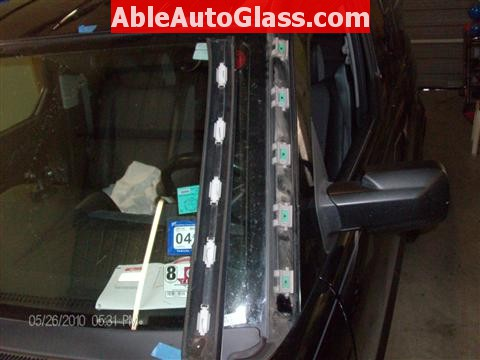 Honda Element 2010 Windshield Replace - Close-up of Clips