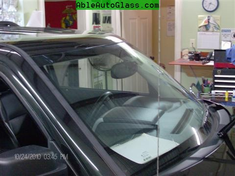 Jeep Patriot 2007-2011 Windshield - Replacement - View of Paper Under Bug (