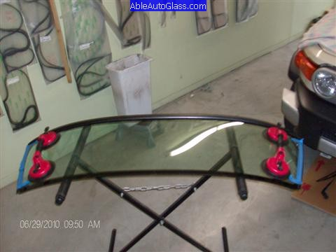 Toyota FJ Cruiser 07-10 Windshield Replacement 2 Suction Cup and Side Molding Applied to Glass