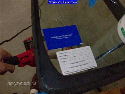 Toyota FJ Cruiser 07-10 Windshield Replacement Heating Up Old Stickers to Transfer to New Windshield