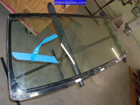 Toyota FJ Cruiser 07-10 Windshield Replacement Old Windshield on Stand